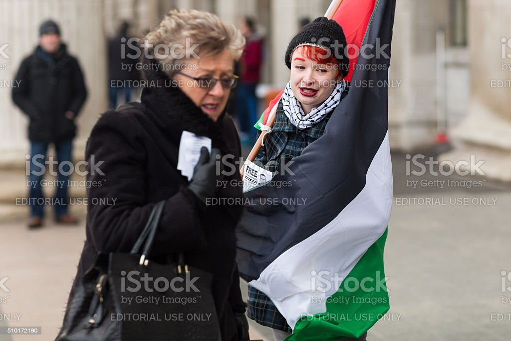 Young adult wrapped in Palestinian flag stock photo