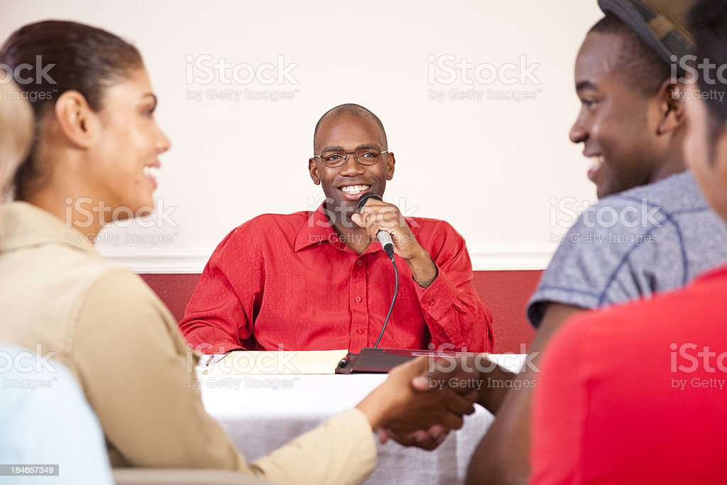 Young adults at a meeting shaking hands. royalty-free stock photo