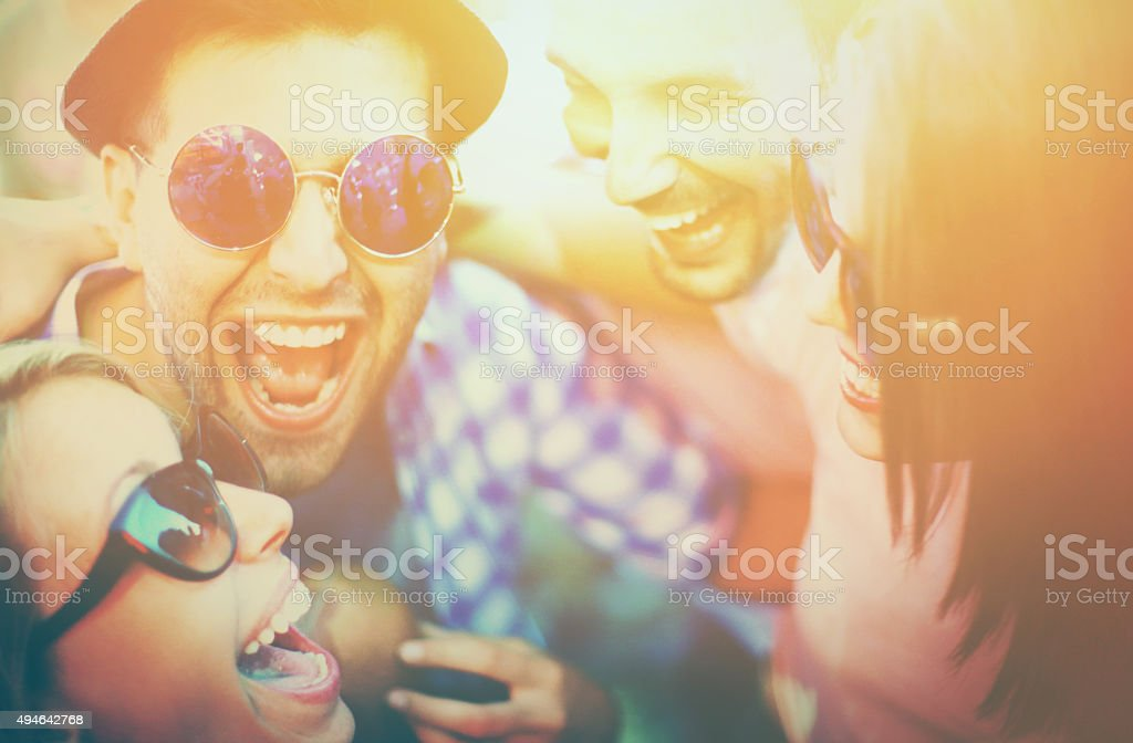 Young adults at concert. stock photo