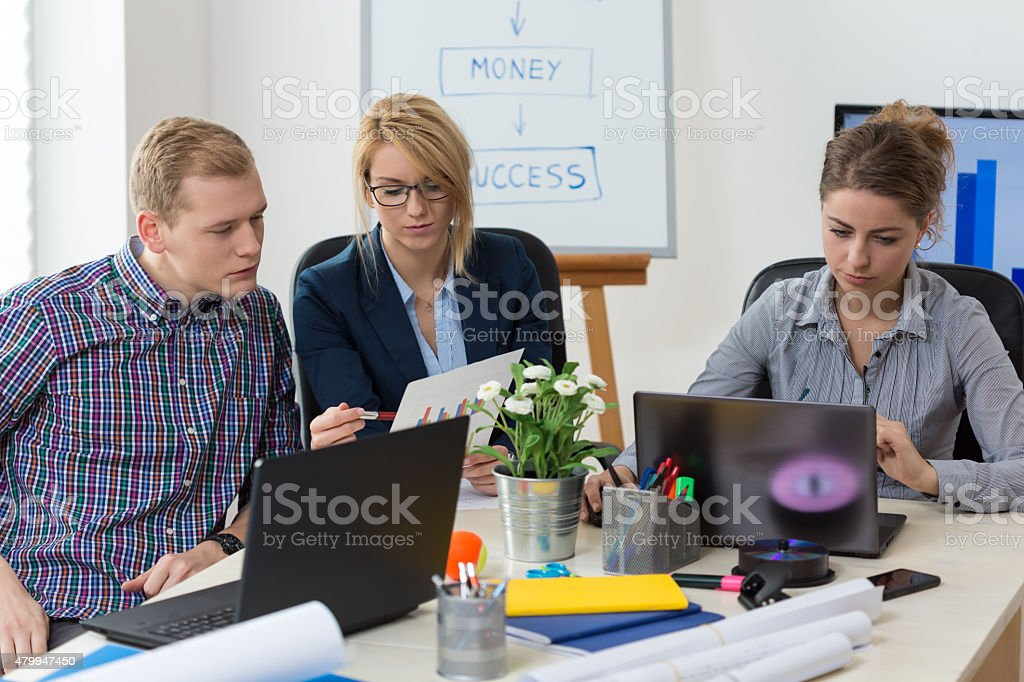 Young adults at office stock photo