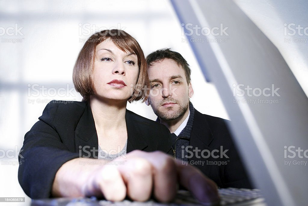 Young adults at work royalty-free stock photo