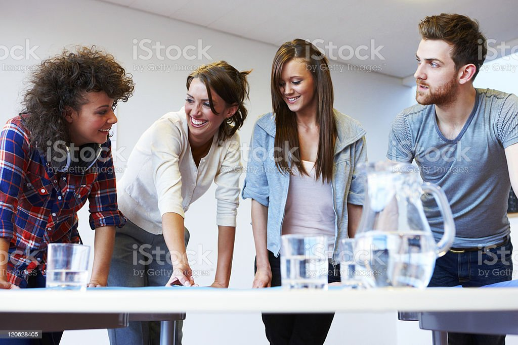 Young Adults Collaborating on a Project royalty-free stock photo