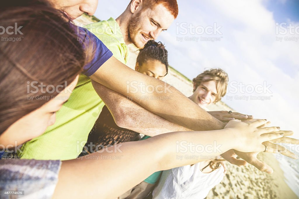 Young adults cooperating together stock photo