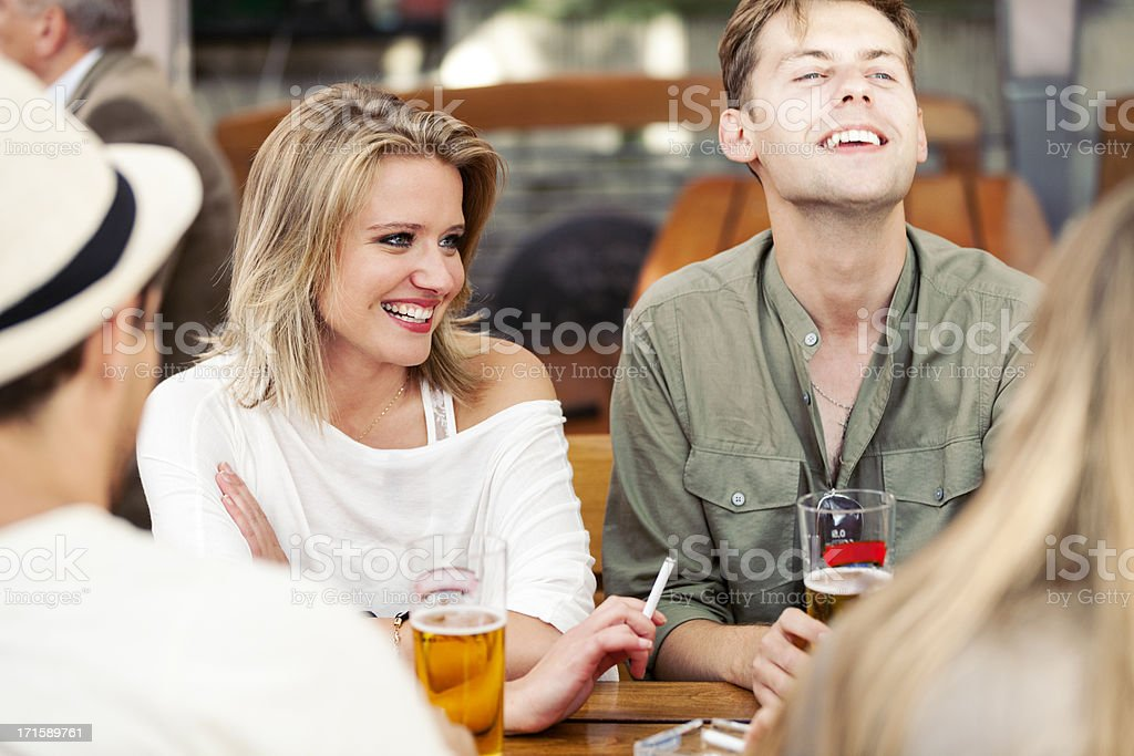 Young Adults Drinking Beer And Smoking royalty-free stock photo