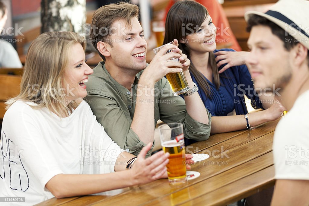 Young Adults Drinking Beer stock photo