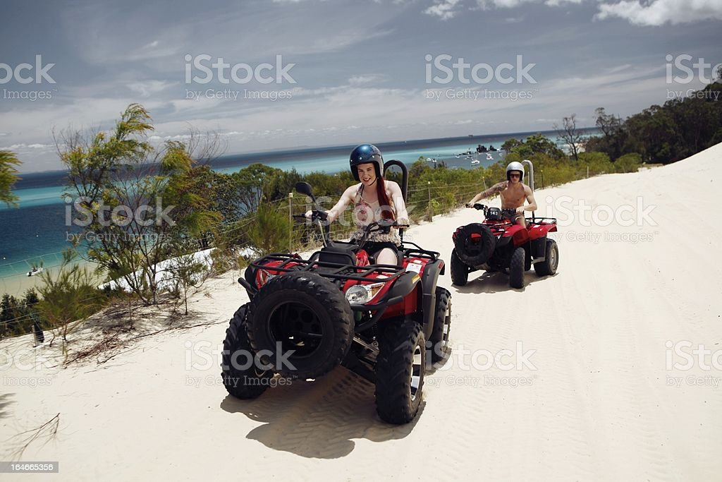 Young Adults Driving Quad Bikes royalty-free stock photo