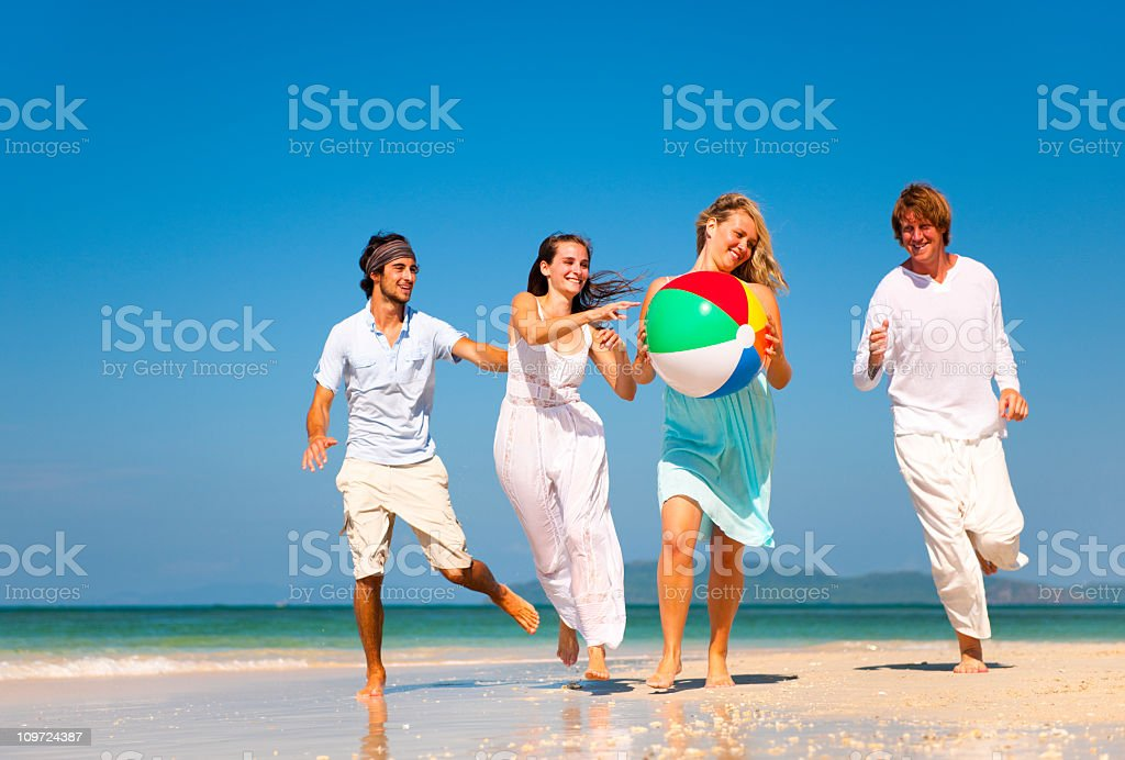 Young Adults enjoying themselves on a tropical beach royalty-free stock photo