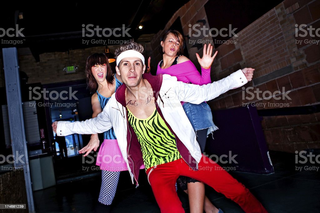 Young Adults Going 80's Dancing royalty-free stock photo