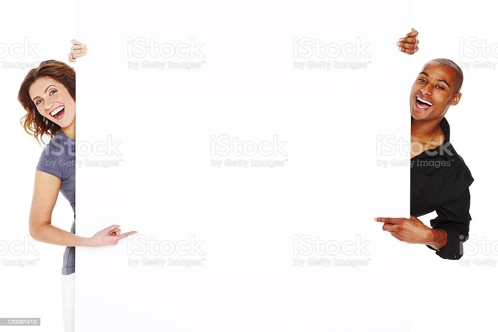 Young Adults Holding Blank Sign - Isolated royalty-free stock photo