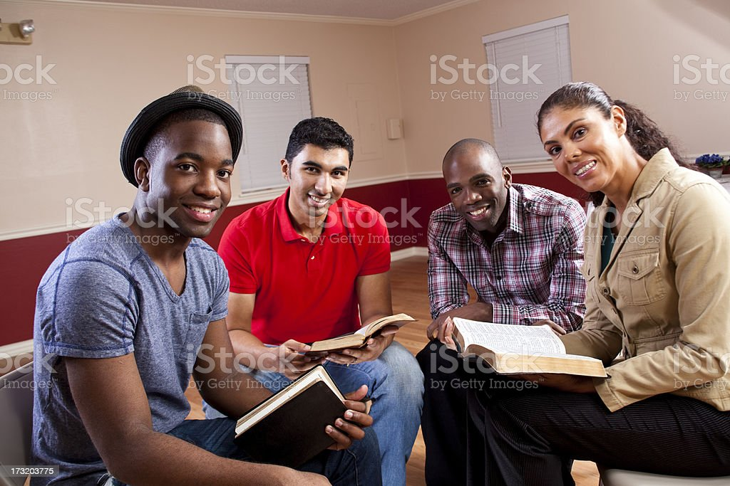 Young adults in a Bible study. stock photo