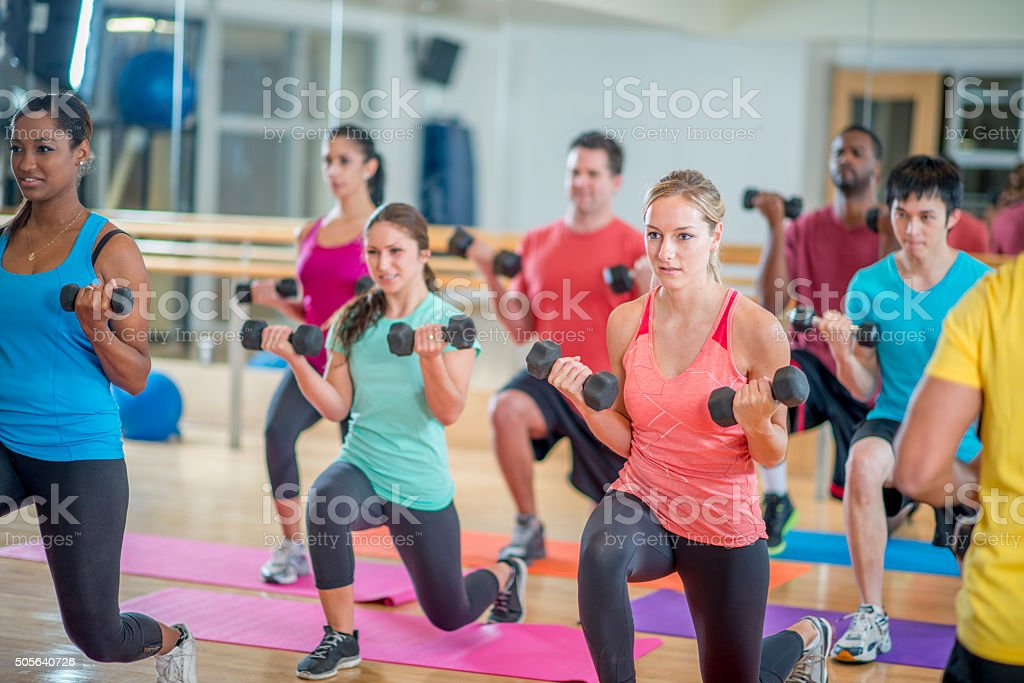 Young Adults in a Fitness Class stock photo