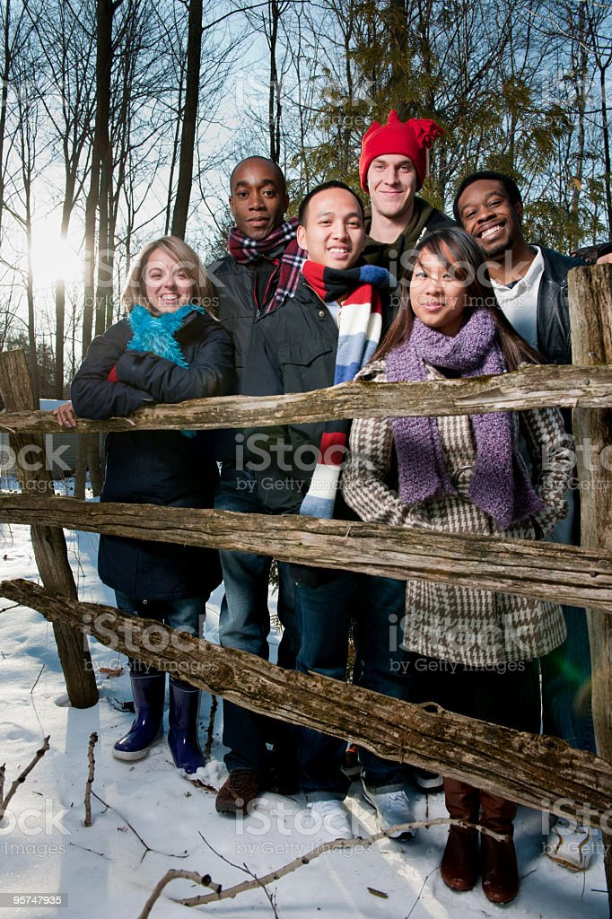 Young Adults in the Snow (lens flare) stock photo