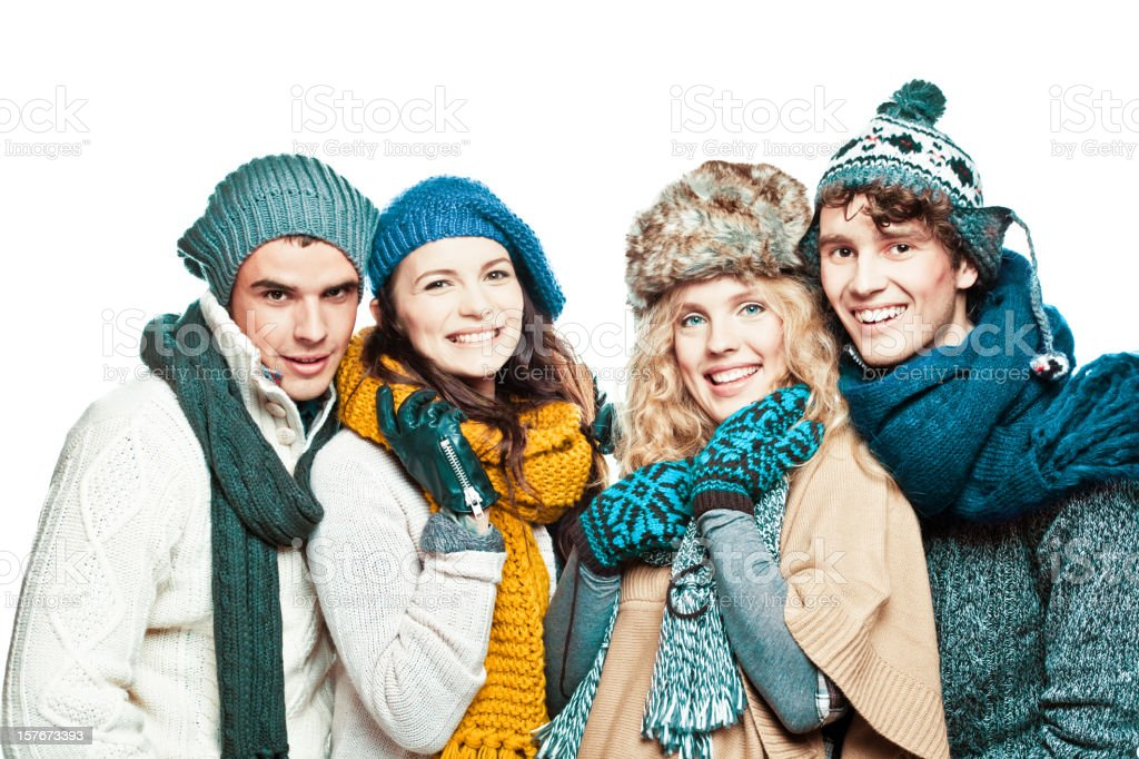 Young adults in winter clothes royalty-free stock photo