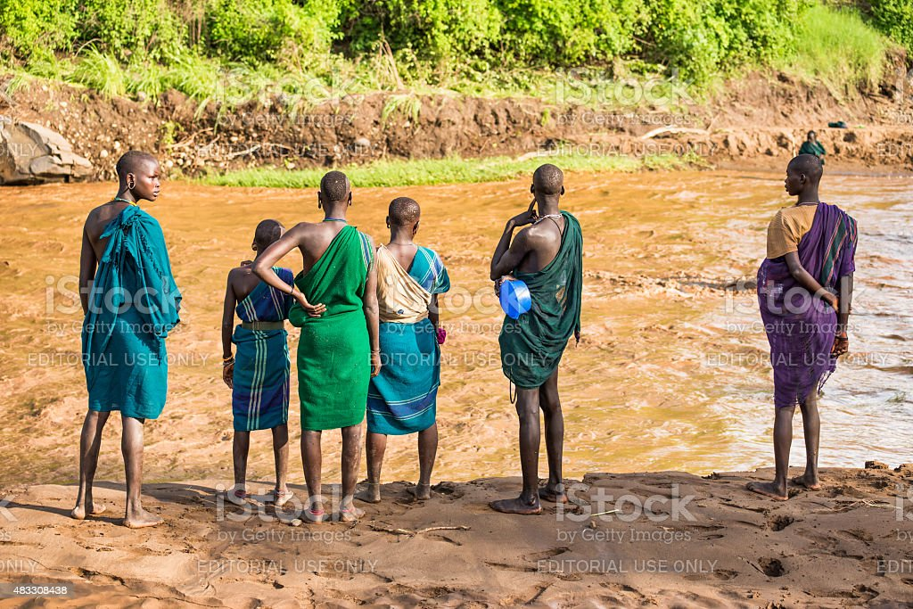 Young adults of the African tribe Suri, Omo Valley, Ethiopia stock photo