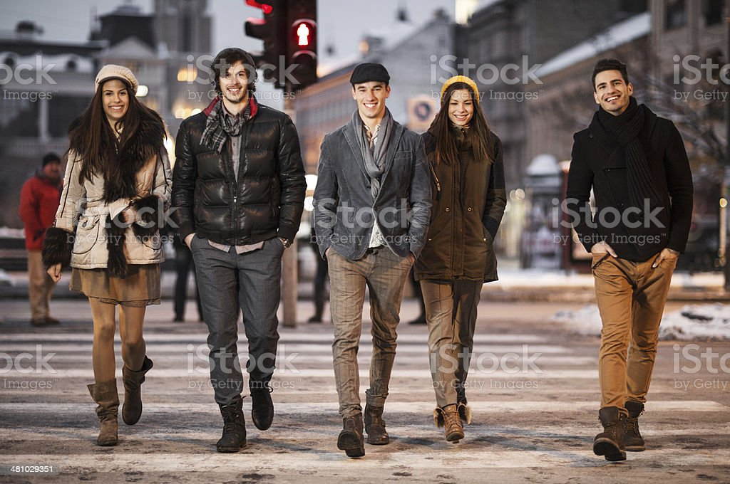 Young adults on Zebra crossing. stock photo