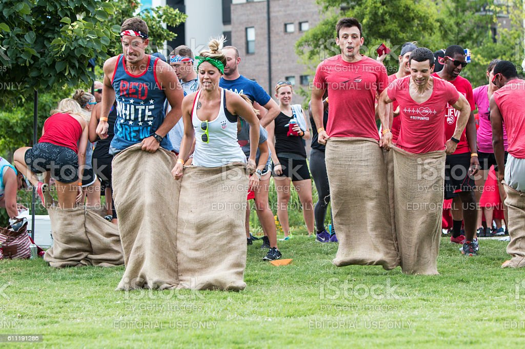 Young Adults Participate In Sack Race At Atlanta Field Day stock photo