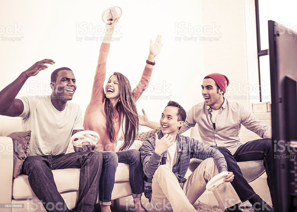 Young Adults Playing Video Games stock photo