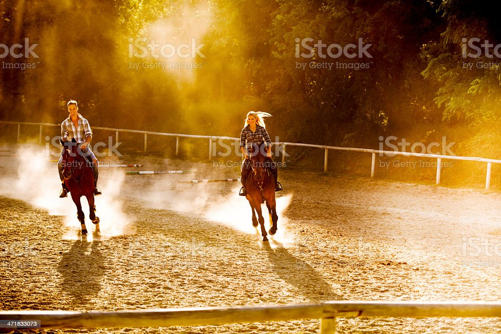 Young adults practicing with their horses. royalty-free stock photo