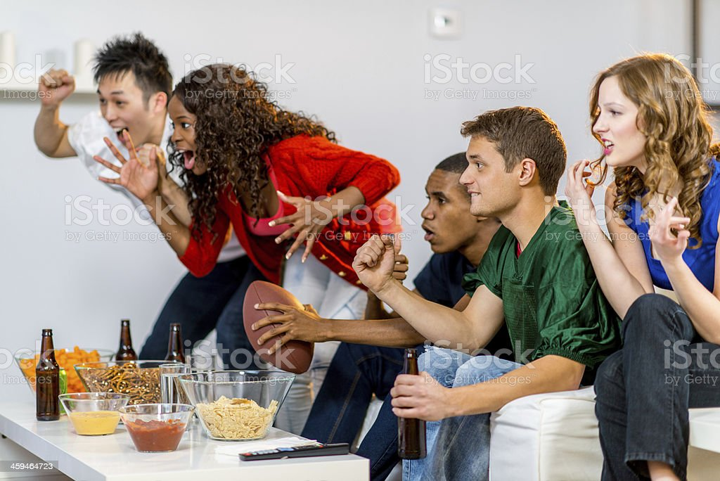 Young adults watching football stock photo