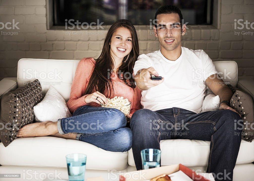 Young Adults Watching TV stock photo
