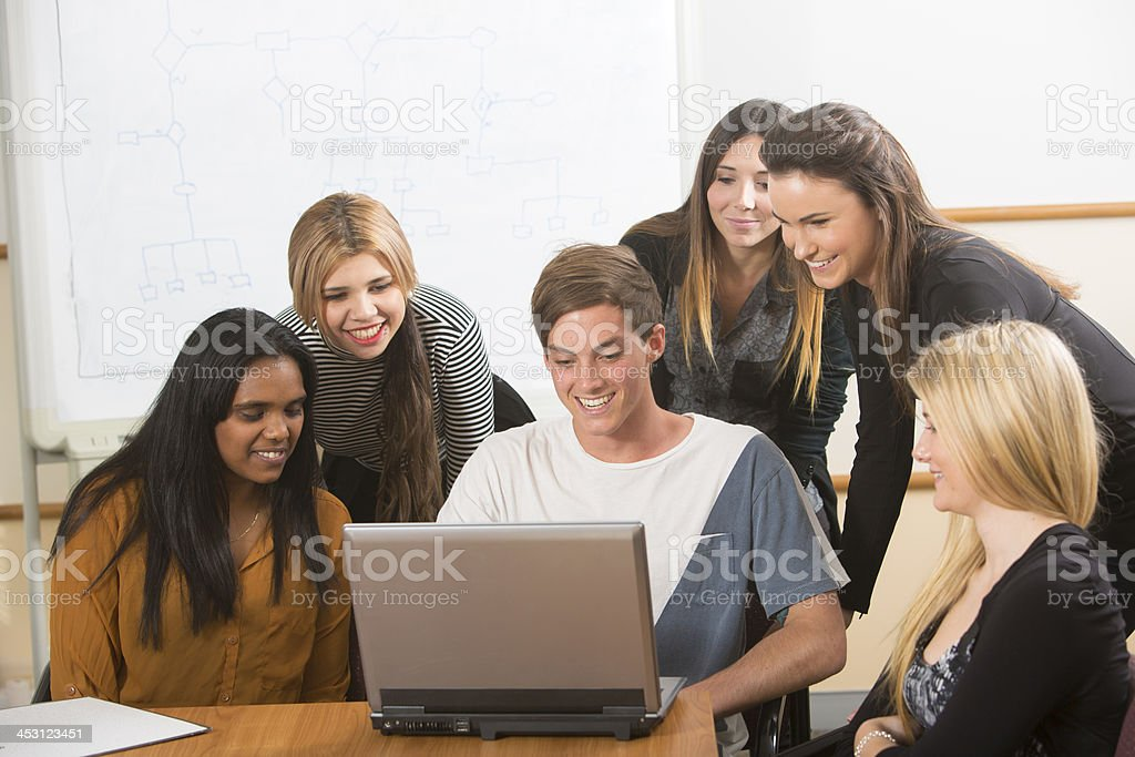 Young Adults With a Computer royalty-free stock photo