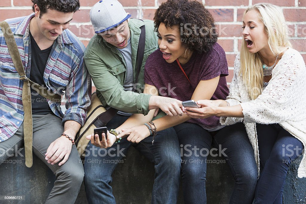 Young adults with mobile phones stock photo