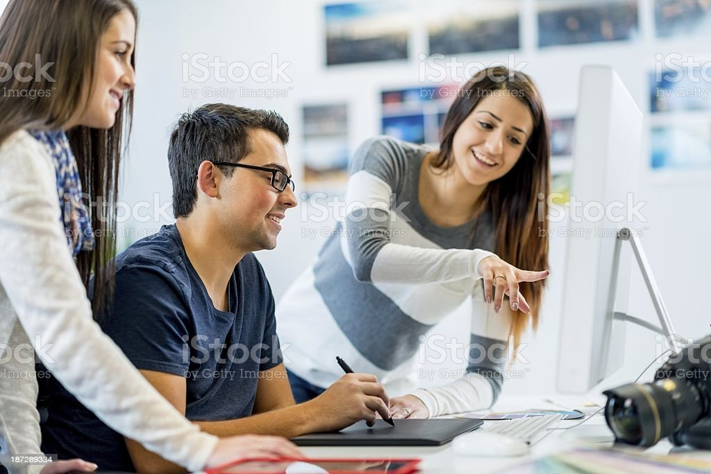 Young Adults Working on Project stock photo