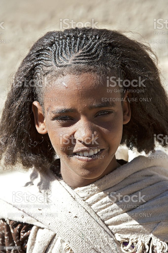 Young Afar woman with typical hairstyle, Danakil Desert, Ethiopia stock photo