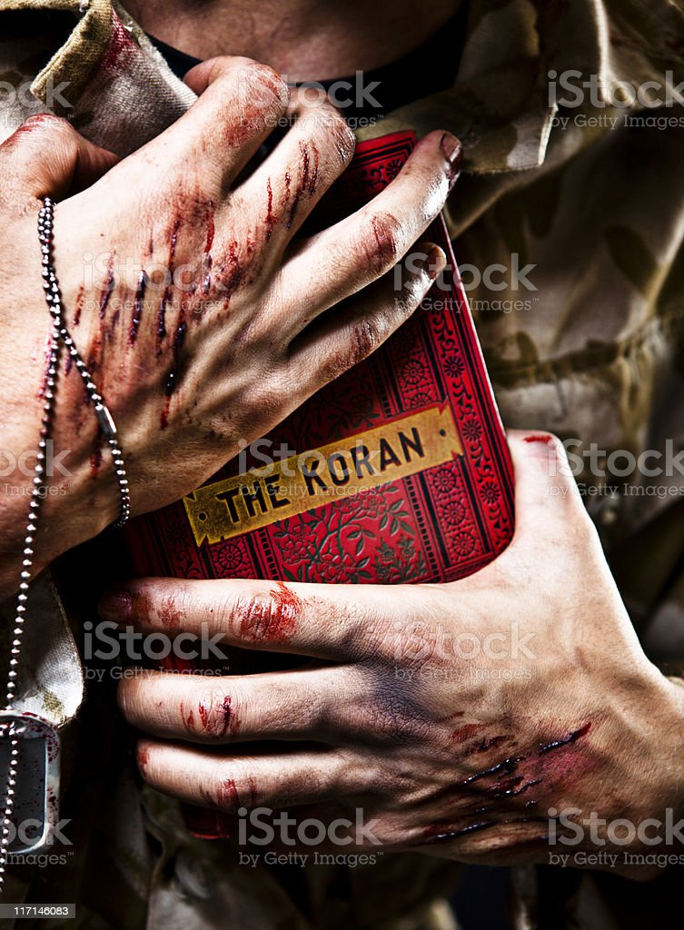 Young Afghan Soldier Clutching Koran royalty-free stock photo
