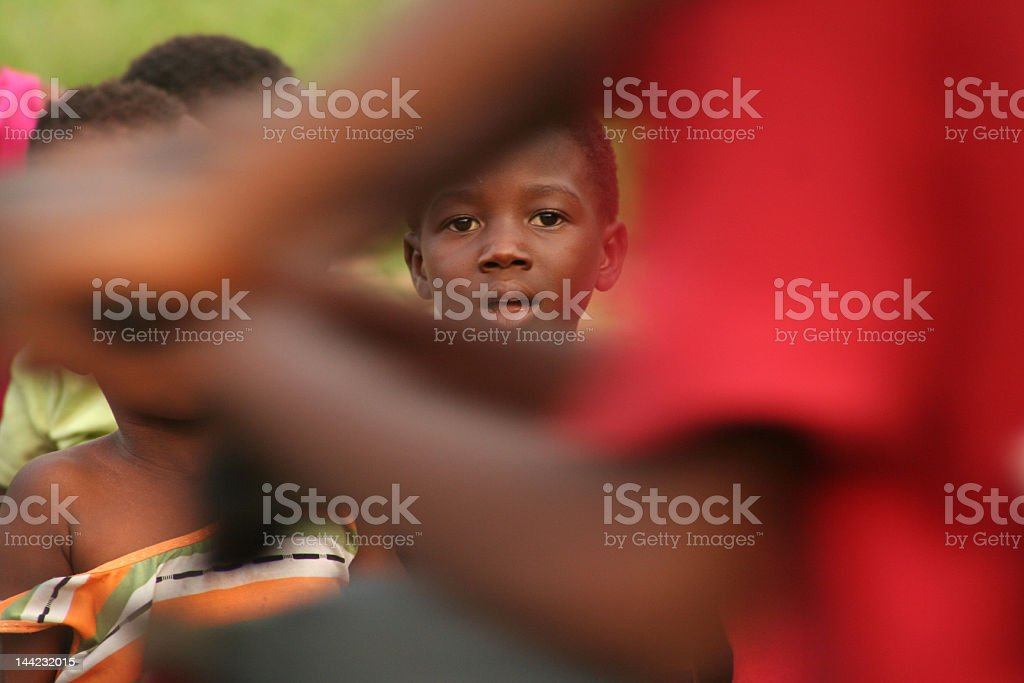 A young African American boy stairs in the background stock photo