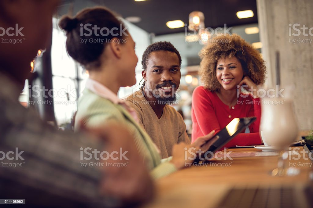Young African American business team talking on a meeting. stock photo