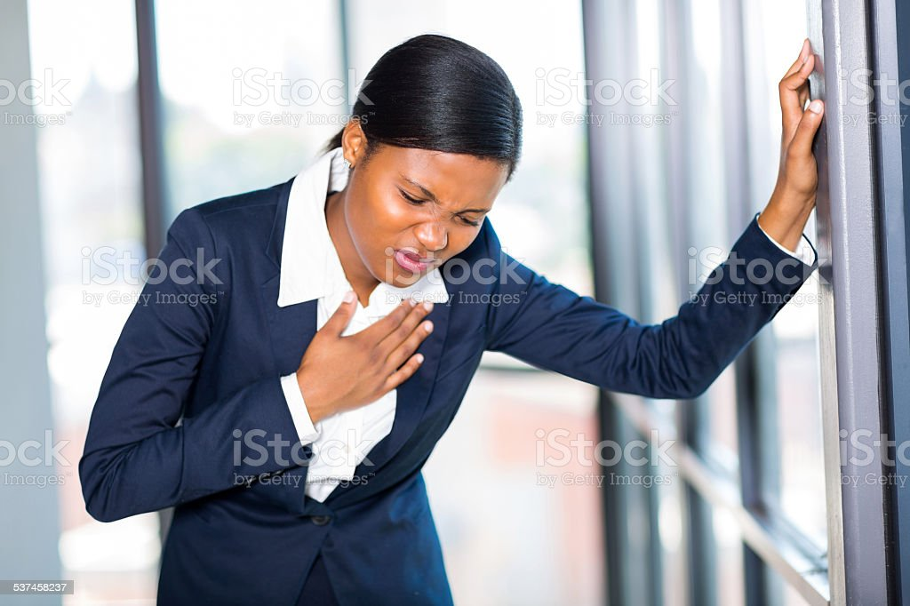 young african american businesswoman having heart attack stock photo