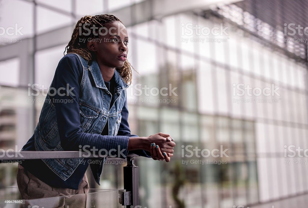 Young African American businesswoman relaxing on a terrace. stock photo