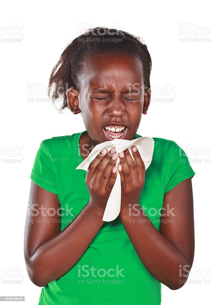 Young African American child sneezing. royalty-free stock photo