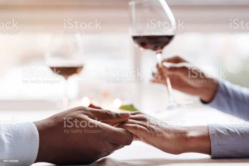 Young African American couple having the date in the restaurant stock photo