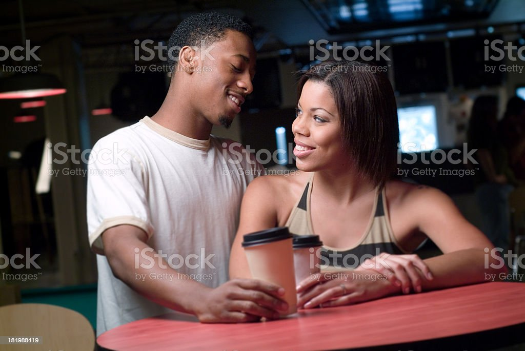 Young African American Couple Talking and Having Coffee stock photo