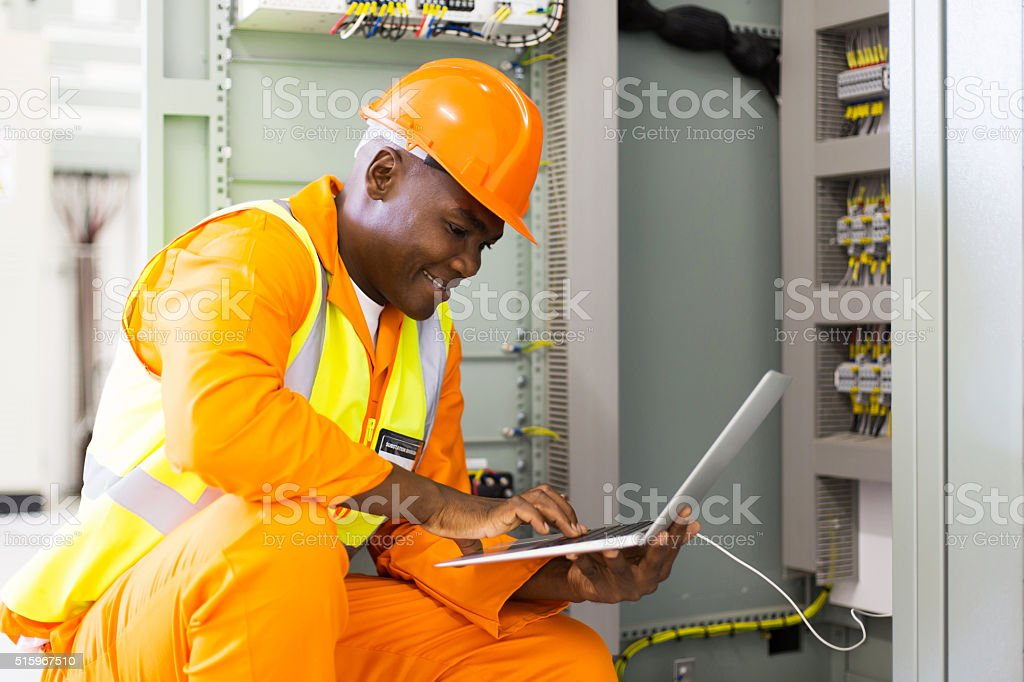 young african american engineer using laptop stock photo