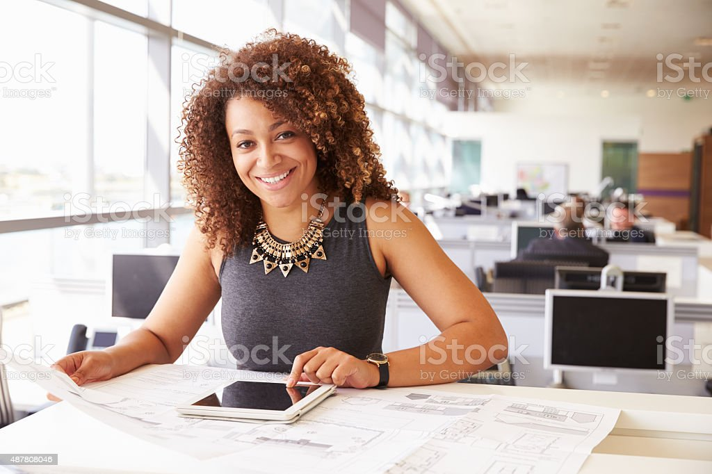 Young African American female architect working in an office stock photo