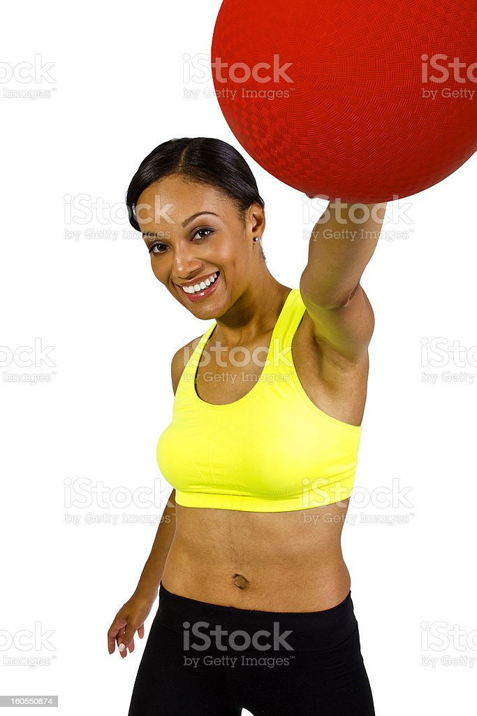 Young African American Female Holding a Red Dodgeball stock photo