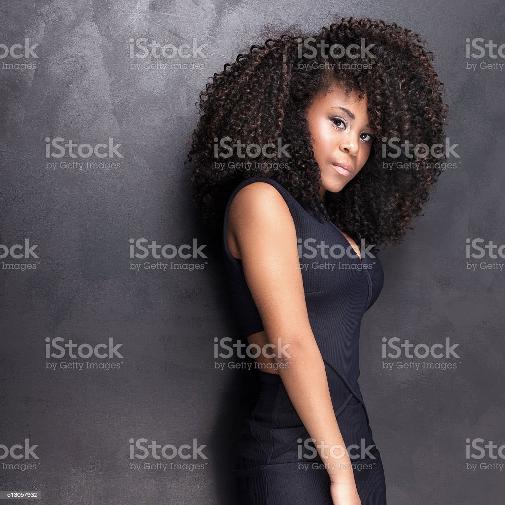Young african american girl posing in studio. stock photo