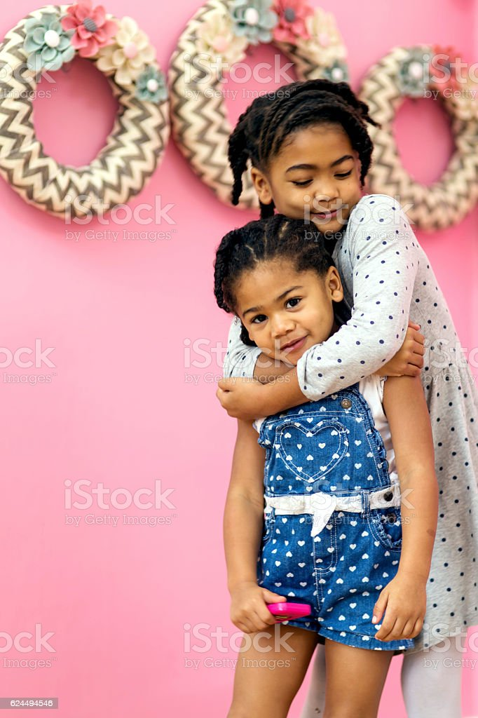 Young African American girls hugging each other stock photo