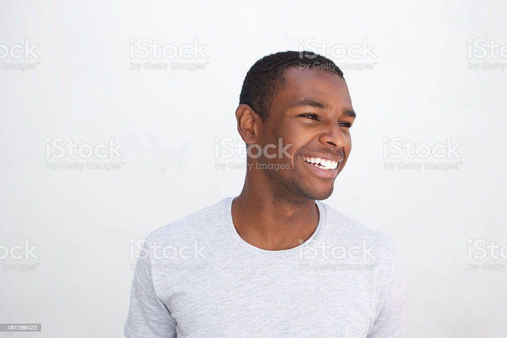 Young african american guy laughing stock photo