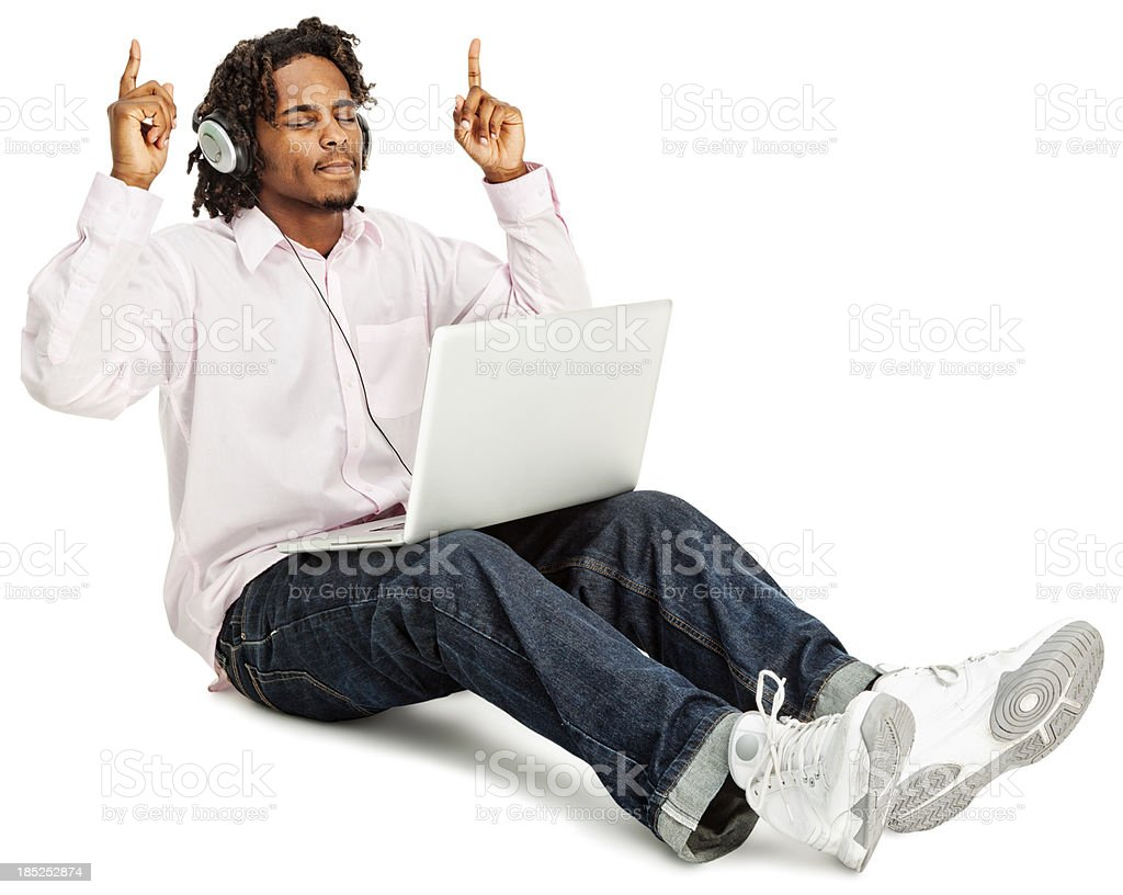 Young African American Male Listening to Music on Laptop royalty-free stock photo