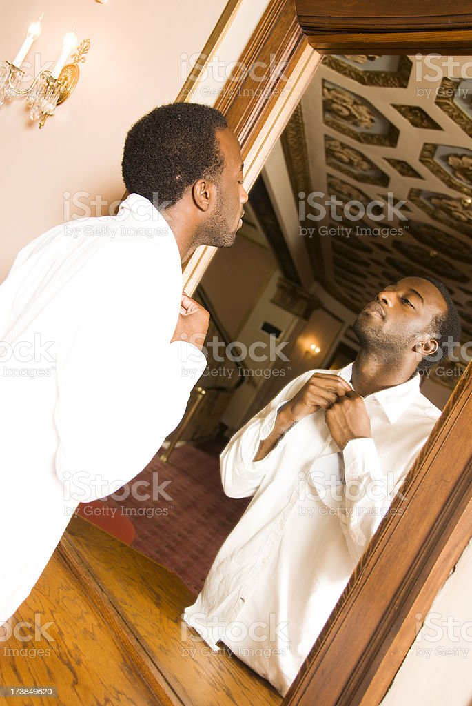 Young African American Male looking in mirror royalty-free stock photo
