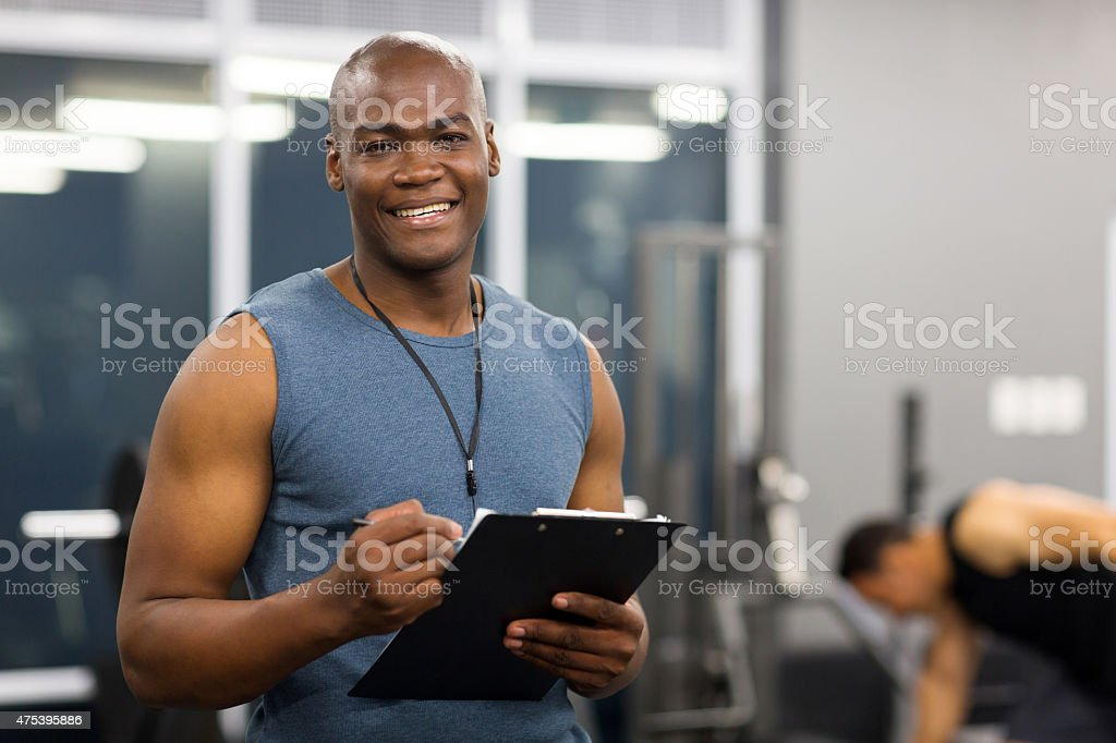 young african american male personal trainer stock photo
