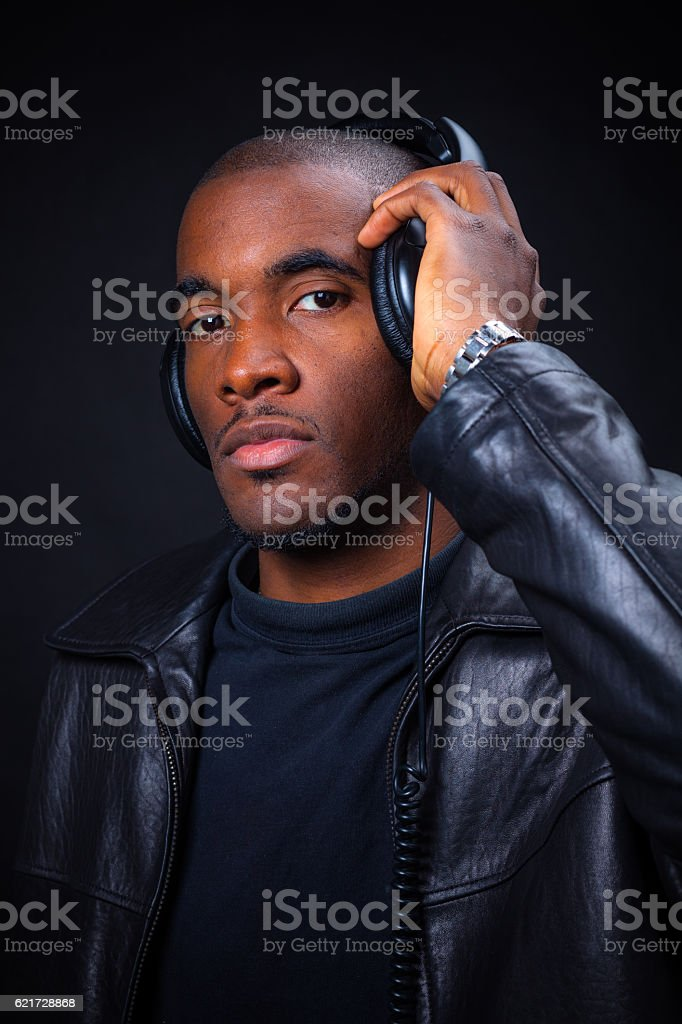 Young African American Man Posing in Studio with Headphones stock photo