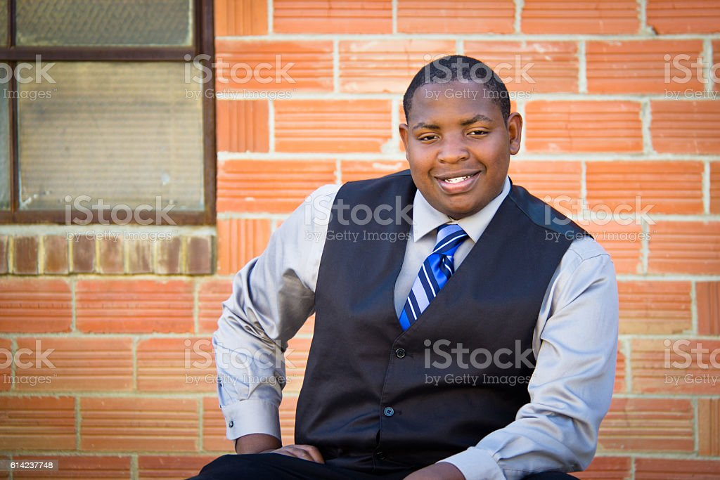 Young African American man sitting posed stock photo