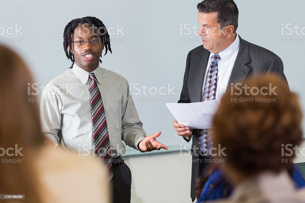 Young African American man speaking during seminar conference stock photo