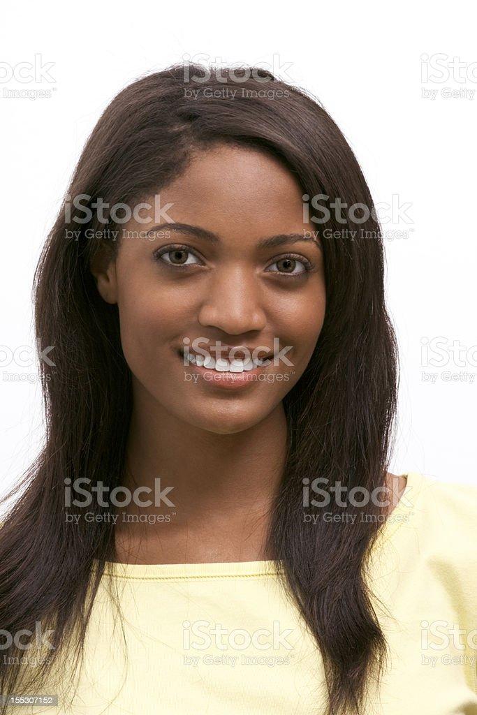Young African American smiling woman wearing yellow shirt stock photo