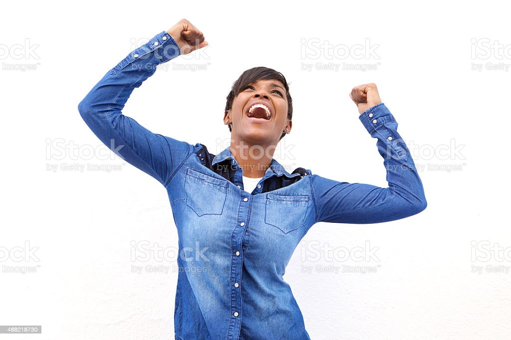 Young african american woman cheering with arms raised stock photo